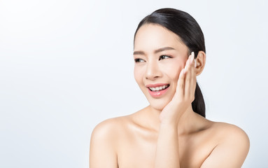 Portrait of attractive asian woman with fair perfect healthy glow skin isolated on white background, asian beautiful girl with pretty smile on her face. Beauty clinic skincare spa and surgery concept