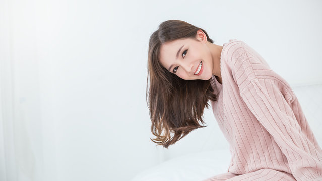 Portrait of young beautiful innocence asian woman relax in her bedroom. Asian girl face wear winter cloth. Beauty long hair treatment perfect clear skin japanese makeup lifestyle concept