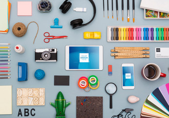 Smartphone and Tablet Surrounded by Art Supplies Mockup