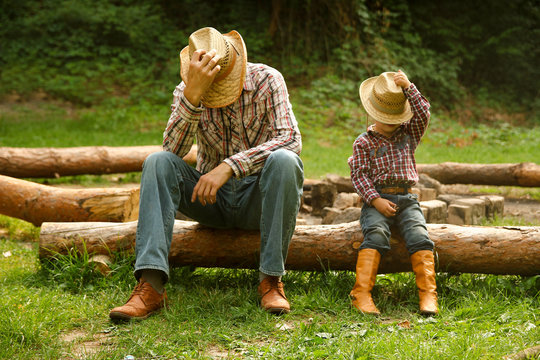 father and son of a cowboy