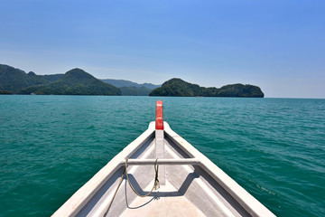 Wall Mural - Front view of a boat sailing across beautiful tropical sea in Langkawi Island, Malaysia