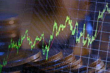 Financial investment concept, Double exposure of city night and stack of coins for finance investor, Forex trading candlestick chart, Digital economy.