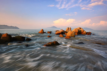 Wall Mural - Rocky beach in Pangkor island during sunrise
