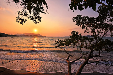 Wall Mural - Beautiful sunset and soft waves over the beach in Langkawi island, malaysia