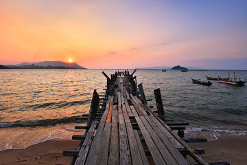 Wall Mural - Wooden jetty over the beach during sunset in Langkawi island, malaysia