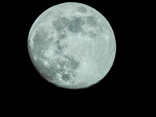 almost full moon in the night sky