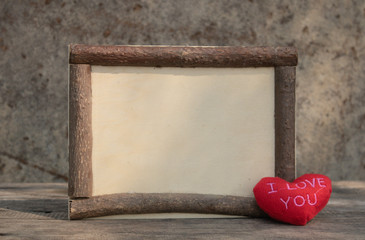wooden frame with heart on the wooden table