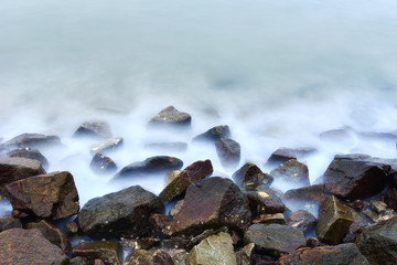 Wall Mural - Long exposure seascape on the rocky beach