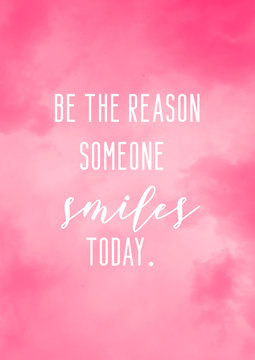 Be the reason someone smiles today. Daily motivational quote card with pink watercolor background.