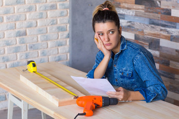Tired exhausted frustrated stressed young woman doing a home renovation