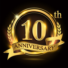 10th golden anniversary logo with ring and ribbon, laurel wreath vector design.