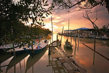Wall Mural - Sunset on the fisherman jetty and boats