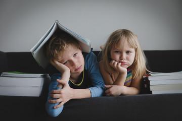 cute boy and girl bored of doing homework, kids stress