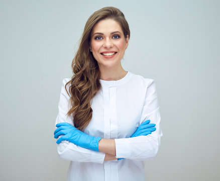 portrait of smiling beautiful woman doctor wearing gloves.