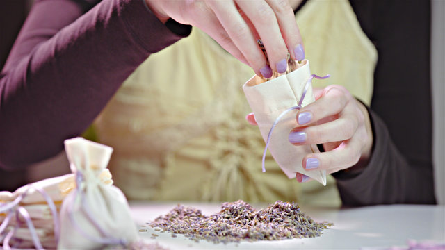 Filling small bag with lavender seeds