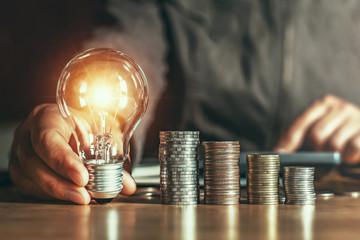 businessman hand holding light bulb. idea concept with innovation and inspiration