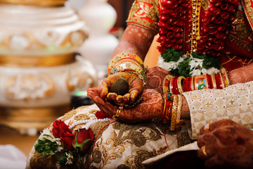 Indian wedding  photography ,groom and bride hands