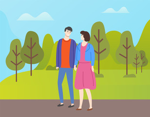 Couple in casual cloth spend time together outdoors. People in love and fall season, man and woman walking in autumn park among yellow and orange trees
