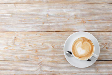coffee art cup on wooden background top view flat lay