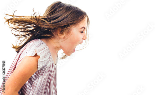 Little girl child yelling, shouting and screaming with bad