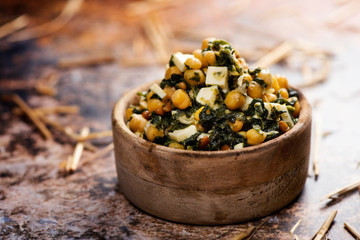 chickpea salad, with spinach, pine nuts and cheese