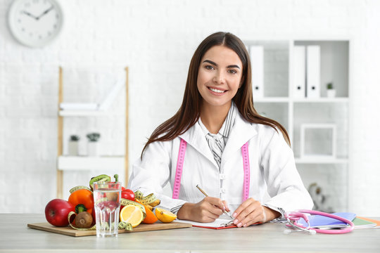Portrait of female nutritionist in her office