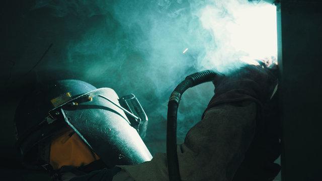 Welder is welding flux cored arc welding ,Industrial welding part in Oil and Gas or Petrochemical