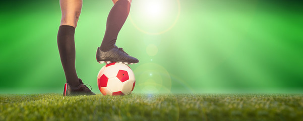 Women soccer, football. Female legs and a soccer ball on the grass, banner, copy space