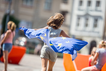 Cute happy young girl with the flag of the European Union Wall mural
