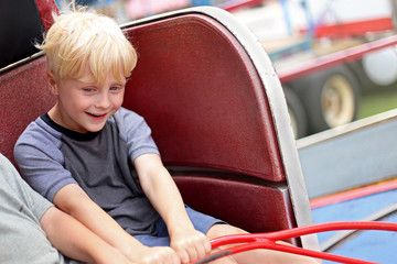 Happy Little Kid Riding Tilt-a-whirl Carnvial Ride