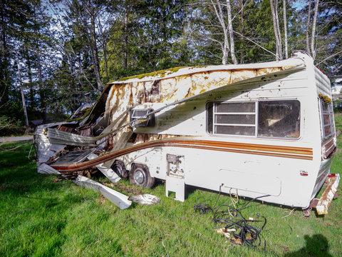 Trashed Trailer. An abandoned trashed trailer on a rural lot.