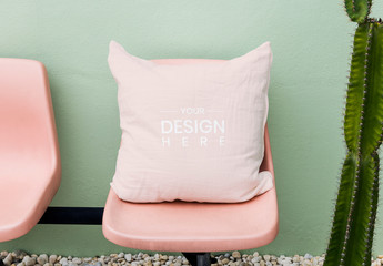 Pillow Mockup on Pink Chair by Green Wall