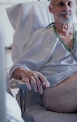 Older man admitted to a hospital room due to health problems