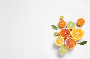 Composition with different citrus fruits on white background, top view Wall mural