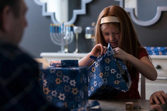 Hanukkah: Child Opening Wrapped Holiday Gift