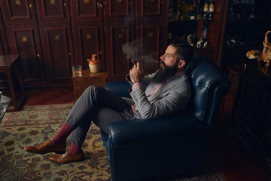 Man smoking cuban cigar