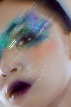Portrait of woman with glitter makeup