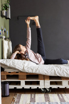 Woman stretching on bed