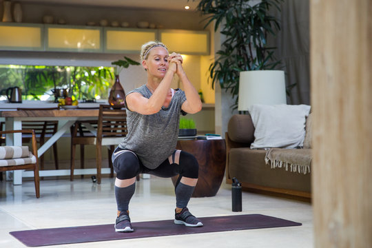 Mature woman exercise at home
