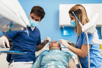 Dentist during a dental intervention.