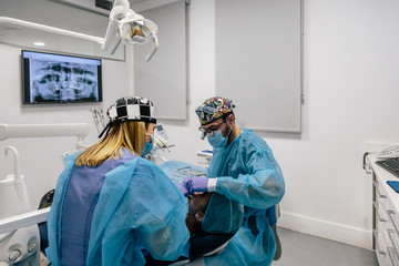 Dentists working on patient during a dental therapy