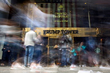 Pedestrians walk past and take pictures in front of Trump Tower on 5th Avenue in the Manhattan borough of New York