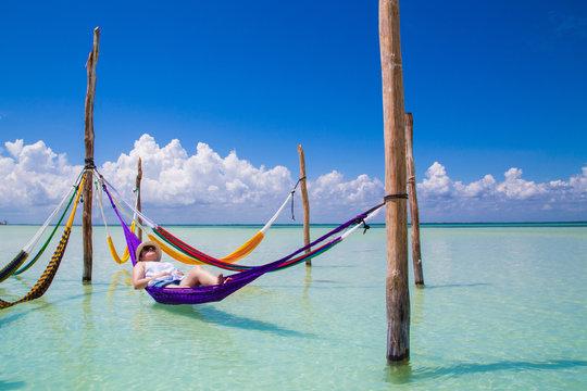 Woman resting at Caribbean beach hammock