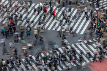 Blurred Motion of People Crossing a Busy Tokyo Street