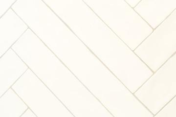 Obraz White tile herringbone pattern wall master bath with gray grout - fototapety do salonu