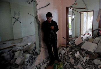 Father of Palestinian assailant Arafat Erfayeh reacts as he stands in his apartment that was partially destroyed by the Israeli forces, in Hebron, in the Israeli-occupied West Bank