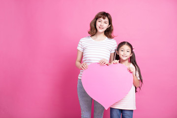 Happy mother's day! Mom and daughter showing love symbol