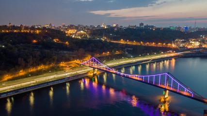 aerial night city view, luminous buildings and bridge.  Drone shot