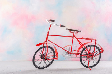 Vintage bicycle on a colored background.