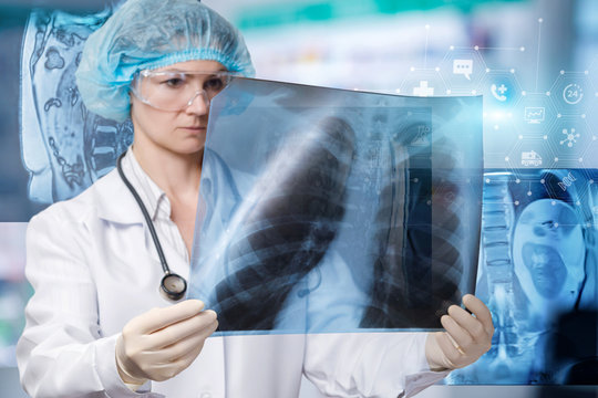 A doctor is examining a lungs image for treatment and diagnosis.